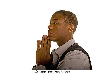 Young Black Man Praying to Side