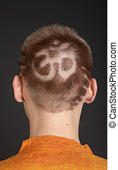 aum symbol for male hair close up
