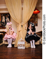 Girls dressed as dolls. - Young women dressed as dolls look...