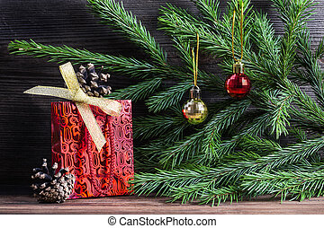 Composition with Christmas decorations. Fir tree cones,...