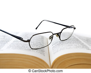 Opened book with glasses