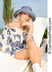 Woman in hat on sea beach. - Young sexual attractive blond...