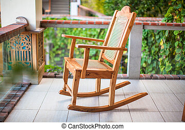 Wooden rocking chair on the terrace of an exotic hotel