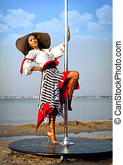 Pole dance girl in dress and hat. - Sexy pole dance girl in...
