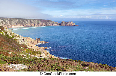 Coast of Cornwall England in autumn with mist and blue sky...