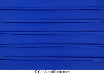 blue background - arranged blue and silky cloth as...