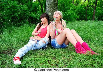 Two beautiful young women friends. - Two beautiful young...