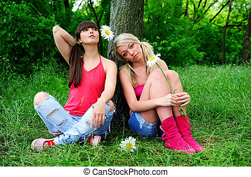 Two beautiful young women friends - Two beautiful young...