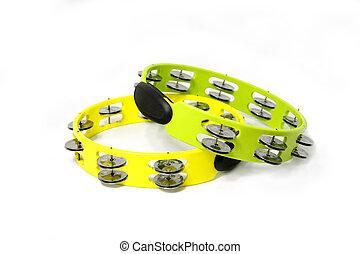 tambourine - yellow and green plastic tambourine on white...
