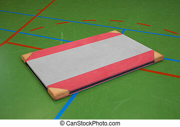 Very old red mat on a blue court, school gym