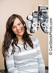 Happy Woman Having Eye Exam