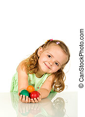 Adorable little girl with easter eggs - isolated - Adorable...