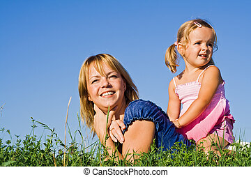 Woman and little girl in the grass
