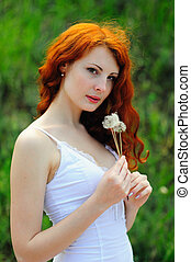 Redhead girl with dandelions. - Redhead girl with...