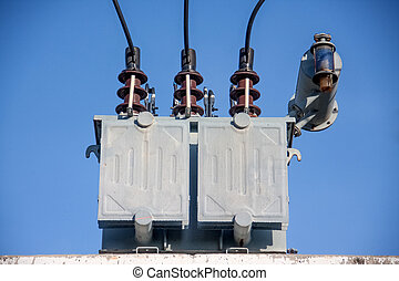 transformer - gray transformer on substations with blue sky