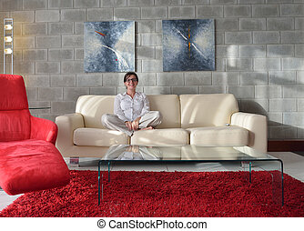 happy young woman relax at home on sofa in bright living...