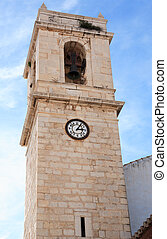 Old Belfry - Closeup of ancient belfry with clock in Spanish...