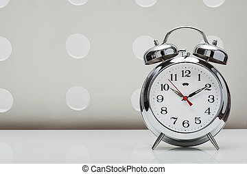 alarm clock - classical alarm clock on vintage background