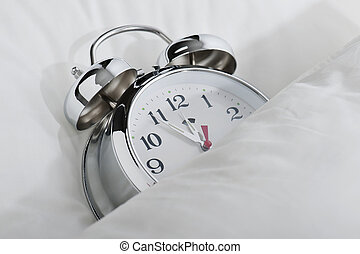 alarm clock - classical alarm clock sleeping on bed until...