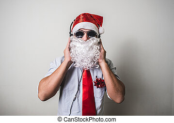 funny santa claus babbo natale listening music on white...