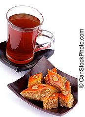 Tea and Baklava Sweets - Cup of Black Tea and Arrangement of...