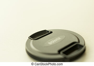 Lens cap isolated on a white background blurred.