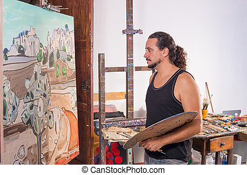 Concentrated painter - Painter looking concentratedly at his...