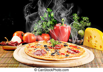 Tasty pizza on plate - Tasty pizza on wooden plate close up...