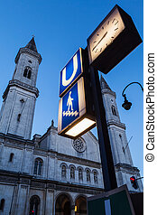 U-Bahn sign and St Ludwigs Church Ludwigskirche in the...