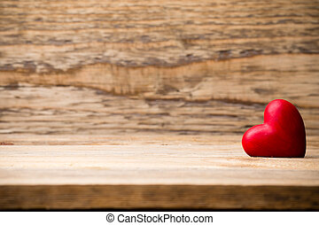 Red heart. - Red heart on the wooden  background.