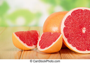 Grapefruit segments on a wooden table, closeup