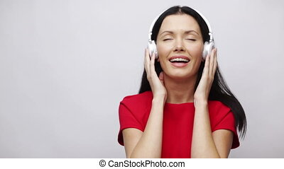 happy singing girl with headphones - music and entertainment...