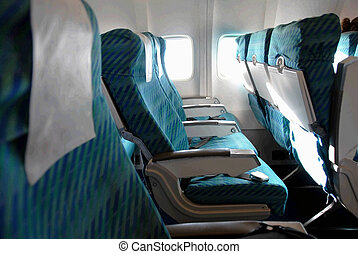 Airplane seat row - row of blue seats indoors in passenger...