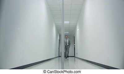 business man walking in corridoor o