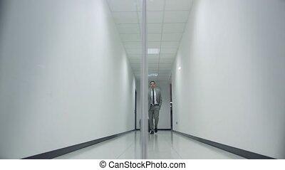 business man walking in corridoor o