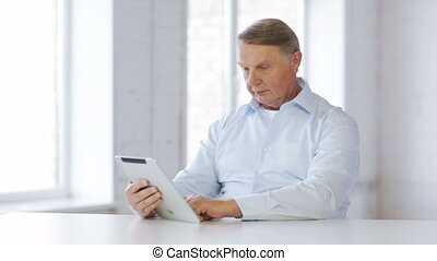 old man with tablet computer at home - business, office,...