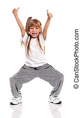 Little girl dancing - Happy little girl dancing isolated on...