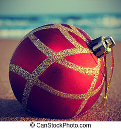 christmas on the beach - picture of a christmas ball on the...