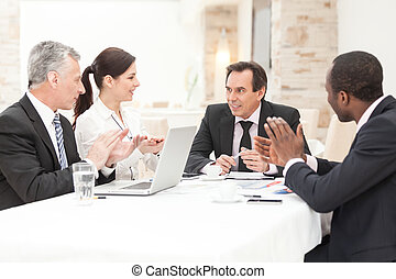 Business People Applauding In a Meeting - Diverse business...