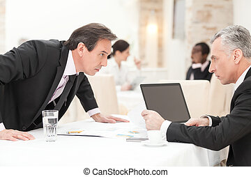 Conflict between two businesspeople.