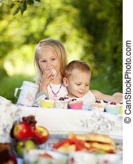 Happy kids - Two happy kids having picnic outside in summer