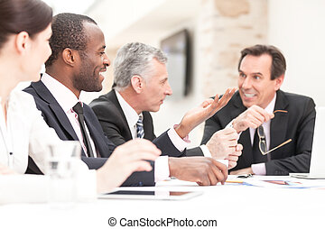 Business Team - Group of business people meeting at table