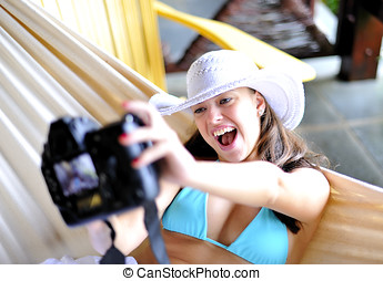 Snapshot - Woman having fun with a digital SLR camera