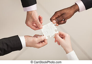 Business Teamwork - Closeup of businesspeople about to put...