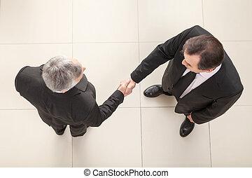 Shaking hands - Businessmen shaking hands. Top View