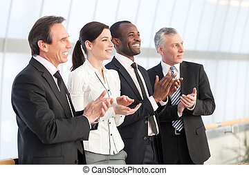 Business team applauding - Professional business team...