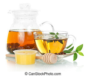 Teapot with mint tea and honey on a white background