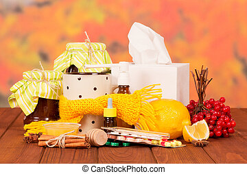 Traditional and medicines for cold against autumn foliage