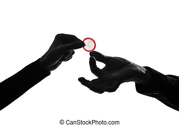 couple man and woman hands holding giving condom close up