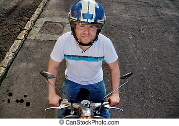 Young man on a scooter